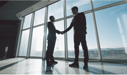 Two man handshaking — Property Investment in Broadbeach, QLD