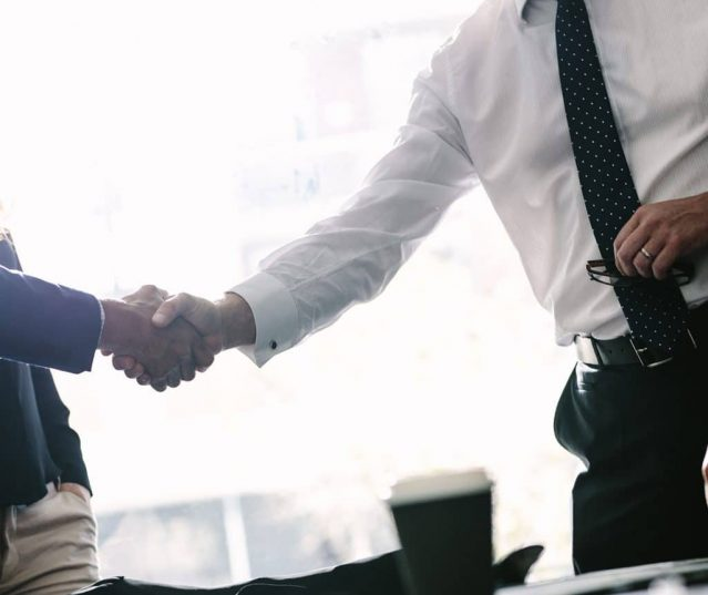 Client and salesman shake hands — Property Investment in Broadbeach, QLD